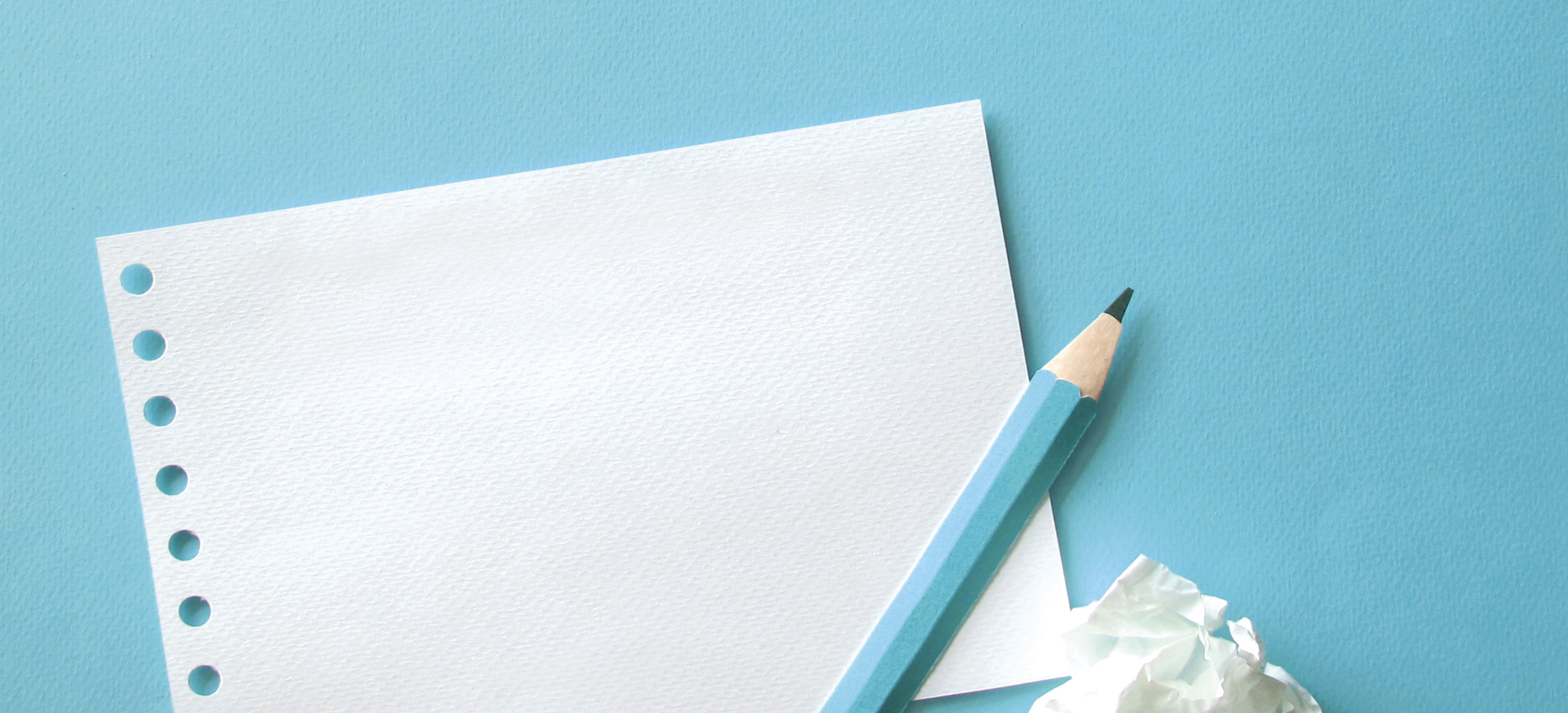 sheet-paper-pen-with-blue-background